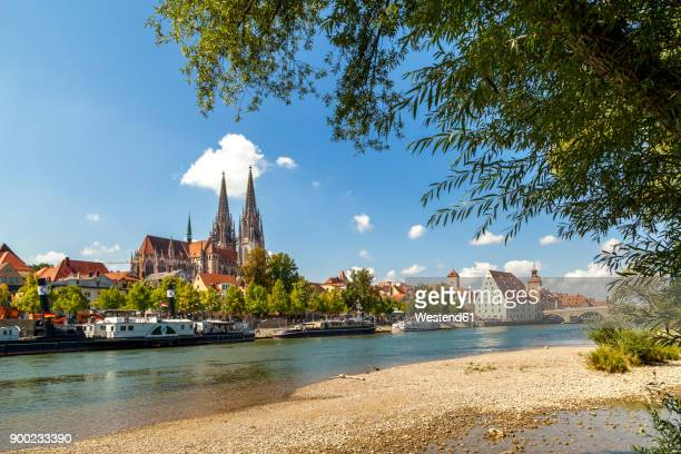 germany, regensburg, vvew to the old town with danube river in the foreground - regensburg stock photos and pictures