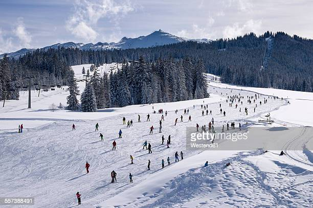 Germany, Reit im Winkl, snow-covered Winklmoosalm with Steinplatte in the background