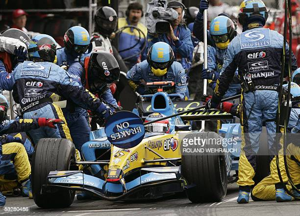 Renault Spanish driver Fernando Alonso stops his car in the pits of the Hockenheim racetrack during the German Grand Prix 24 July 2005 in Hockenheim...