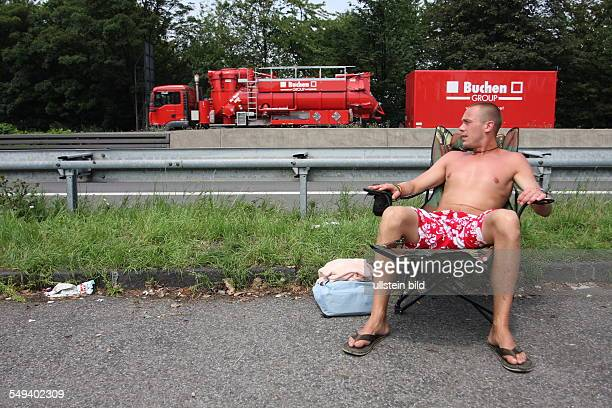 """Germany, Reportage """"Living at the highway 40"""". Muelheim, Reggae music festival, camping at the crash barrier"""