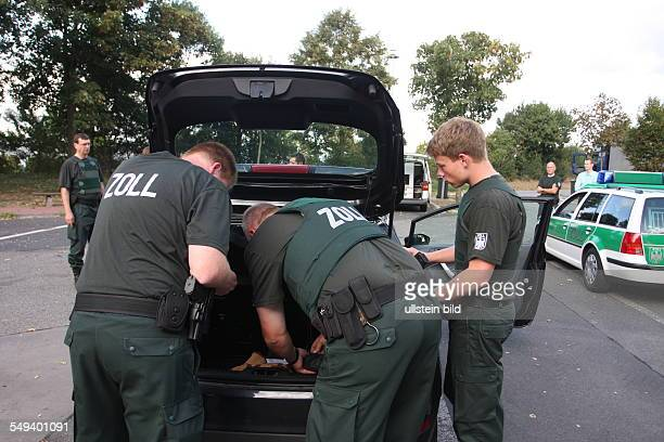 """Germany, Reportage """"Living at the highway 40"""". Wankum. Customs officers check cars and trucks, mainly for drugs"""