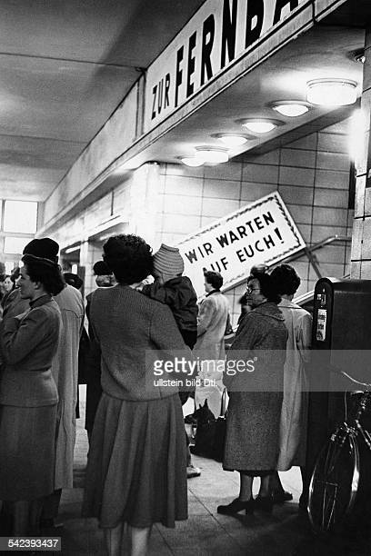 Germany return from war captivity women waiting in the station Zoologischer Garten for the arrival of former prisoners of war Photographer Gert...