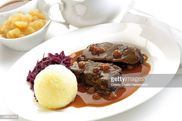 Germany, Rheinland, Roasted beef with dumplings on plate, close-up