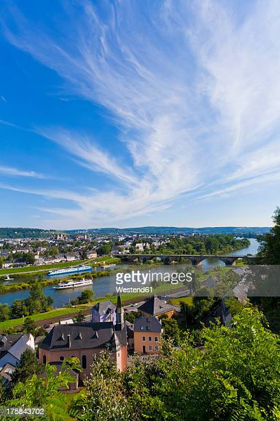 Germany, Rhineland Palatinate, Trier, Excursion boat in Mosel River with cityscape