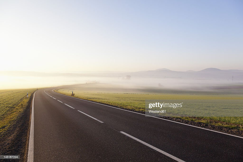 Germany, Rhineland Palatinate, View of empty country road : Stock Photo