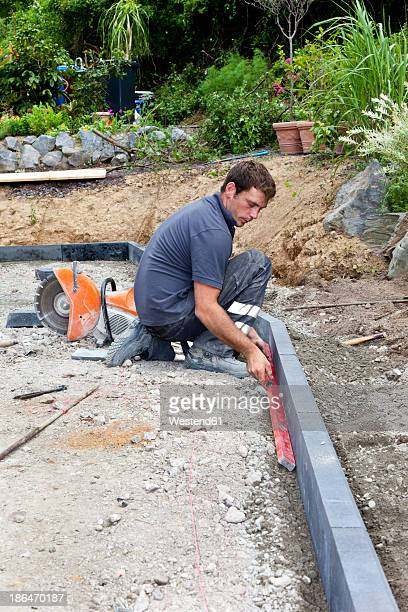 Germany, Rhineland Palatinate, Young man working at construction site