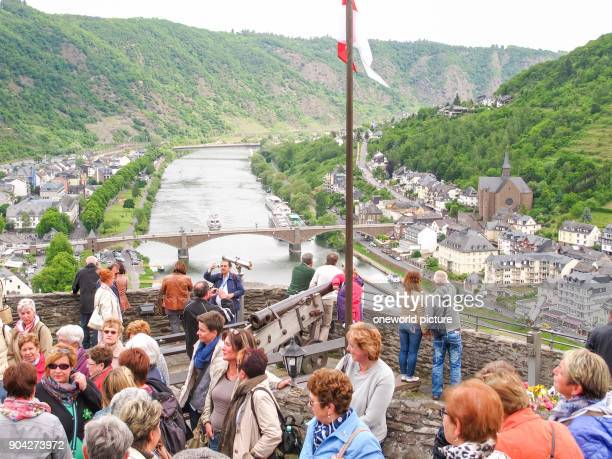 Germany, Rhineland-Palatinate, Cochem, On the Mosel steep path, view from the Reichscastle on Cochem, river with wooded slopes and people in the...