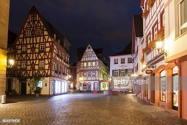 germany, rhineland-palatinate, mainz, kirschgarten square, half-timbered house at night - mainz stock-fotos und bilder