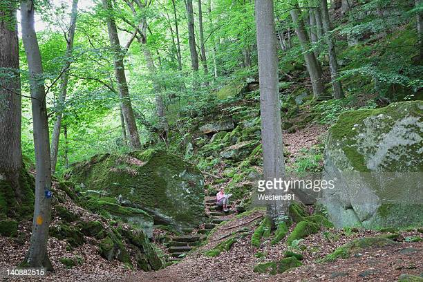 Germany, Rhineland-Palatinate, Mature woman hiking in nature park
