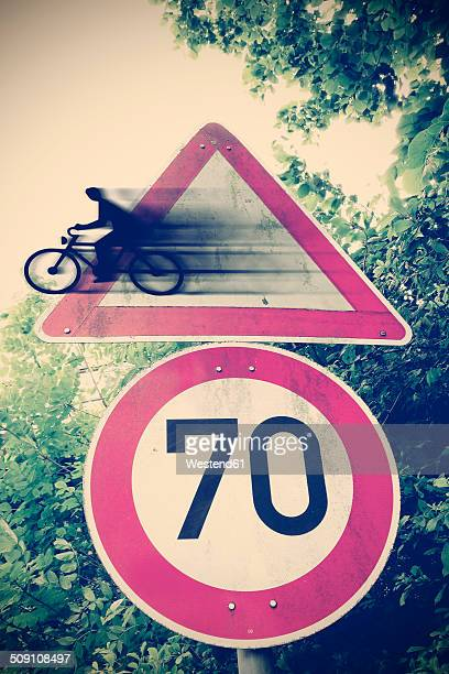 Germany, Road signs, Biker coming out of warning sign