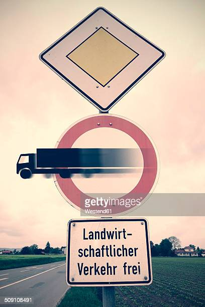Germany, Road signs, Truck coming out of warning sign