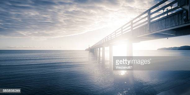 Germany, Ruegen, Binz, sunset at pier