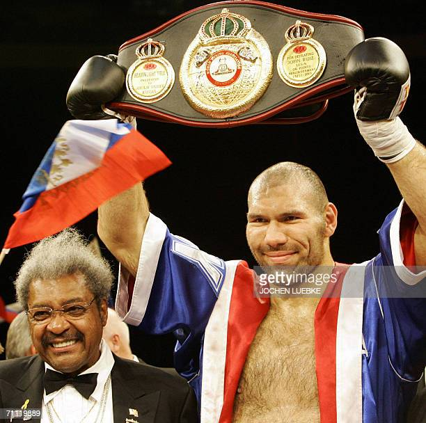 Russian boxer Nikolai Valuev stands beside US box promoter Don King as he celebrates after winning the WBA World Championship heavyweight fight...