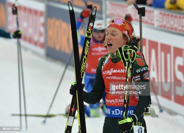 Germany 's Laura Dahlmeier reacts in the finish of the women 125 kilometer mass start competition of the Biathlon World Cup on January 14 2018 in...