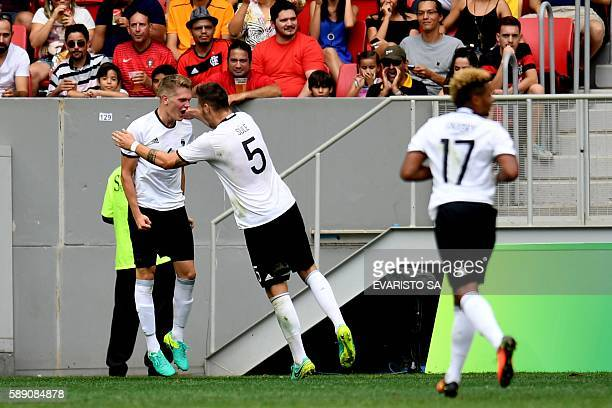 Germany 's player Matthias Ginter celebrates with teammate Niklas Sule after scoring against Portugal during the Rio 2016 Olympic Games Quarterfinals...