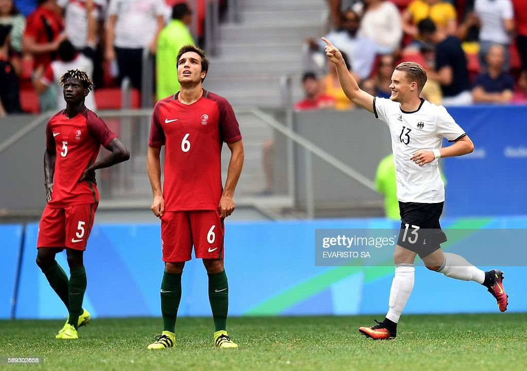 Germany 's player Philipp Max celebrates after scoring against Portugal during the Rio 2016 Olympic Games Quarter-finals men's football match Portugal vs Germany, at the Mane Garrincha Stadium in Brasilia on August 13, 2016. / AFP / EVARISTO SA