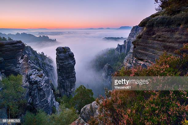 Germany, Saxon Switzerland National Park, Bastei, Hoellenhund at Raaber Kessel at sunrise