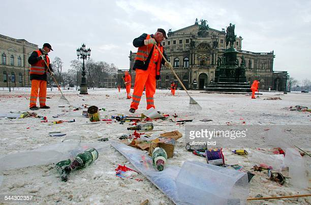 Germany, Saxonia, Dresden. New Year's Day. Dustmen cleaning the square at the Semper Opera House after the party.
