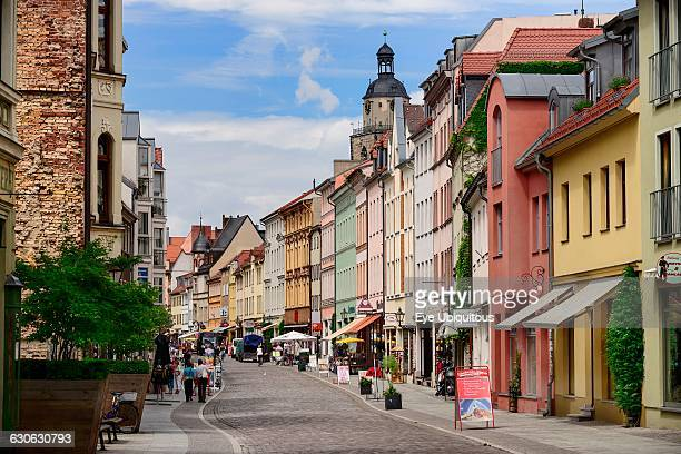 Germany Saxony Anhalt Lutherstadt Wittenberg Colourful vista of buildings in Collegienstrase