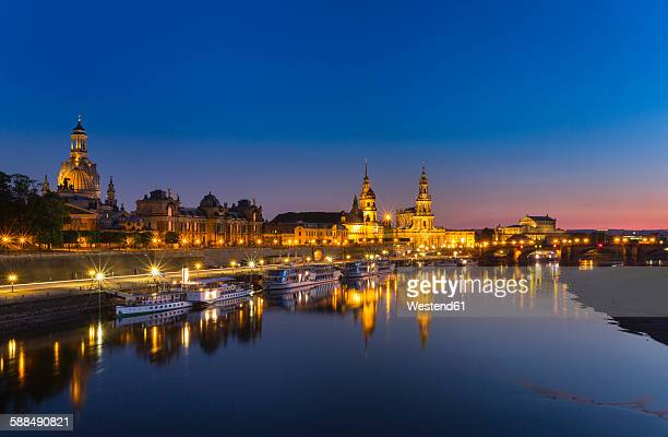 Germany, Saxony, Dresden, Lighted historic old town with Elbe River in the foreground at night