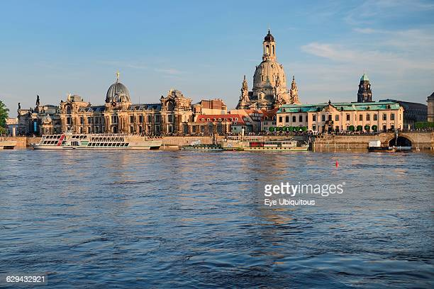 Germany Saxony Dresden The city skyline with cruise boats moored on the flooded River Elbe in front of the embankment buildings on the Bruhl Terrace...