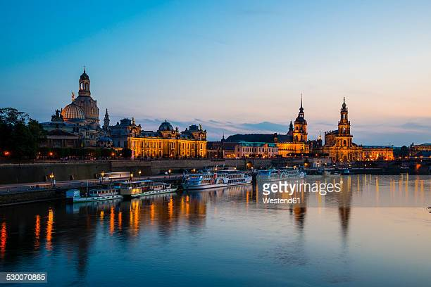 Germany, Saxony, Dresden, View of Academy of Fine Arts, Bruehl's Terrace, Sekundogenitur, Hausmann Tower, House of the Estates,  Dresden Cathedral, Semper Opera House and Augustus Brigde with Elbe waterfront in the evening