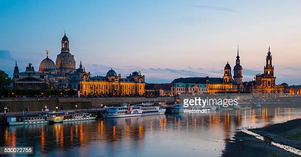 Germany, Saxony, Dresden, View of Academy of Fine Arts, Bruehl's Terrace, Sekundogenitur, Hausmann Tower, House of the Estates and Dresden Cathedral with Elbe waterfront in the evening