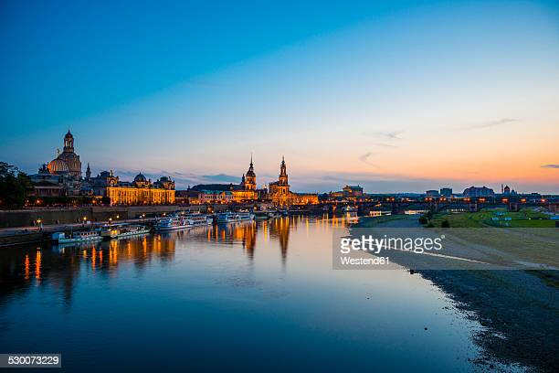Germany, Saxony, Dresden, View of Academy of Fine Arts, Bruehl's Terrace, Sekundogenitur, Hausmann Tower, House of the Estates, Dresden Cathedral, Semper Opera House and Augustus bridge with Elbe waterfront in the evening