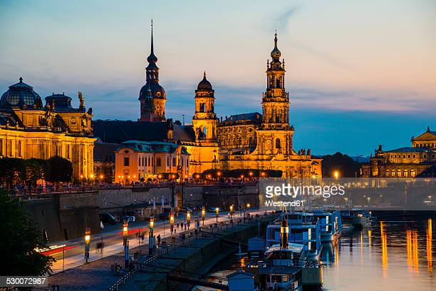 Germany, Saxony, Dresden, View of Bruehl's Terrace, Sekundogenitur, Hausmann Tower, House of the Estates, Dresden Cathedral, Semper Opera House and Augustus bridge with Elbe waterfront in the evening