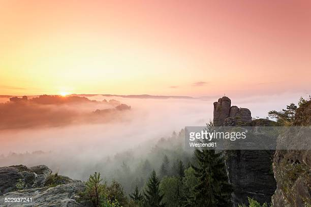 Germany, Saxony, Elbe Sandstone Mountains, view to 'Talwaechter' and 'Verlorener Turm' in the morning mist