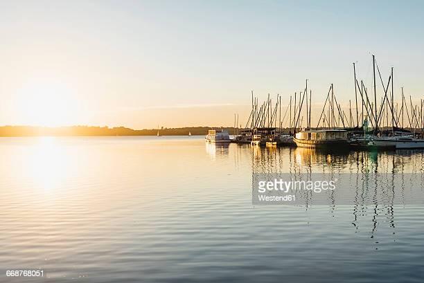 Germany, Saxony, Leipzig, Lake Cospuden, Harbour at sunset