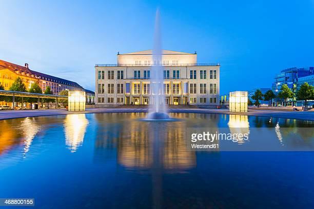 germany, saxony, leipzig, opera house at dusk - opernhaus stock-fotos und bilder
