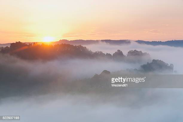Germany, Saxony, morning mist at Elbe Sandstone Mountains