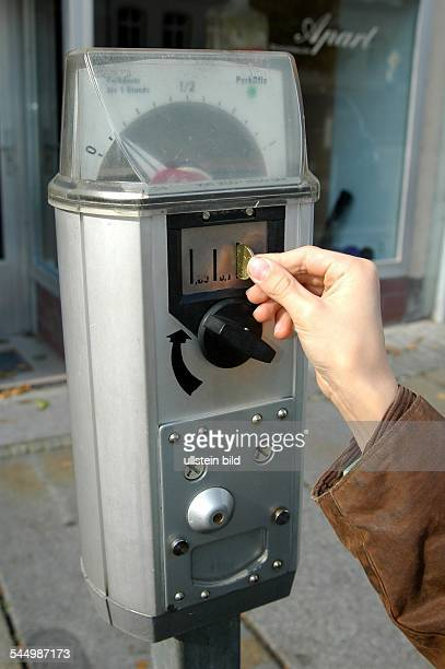 parking meter with coins in Pirna