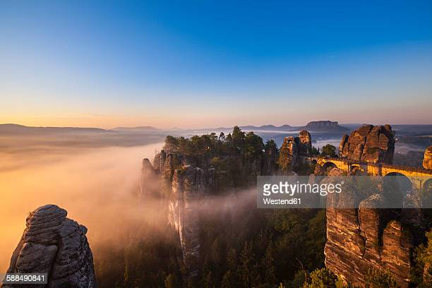 Germany, Saxony, Saxon Switzerland National Park, Elbe Sandstone Mountains and Bastei bridge at dawn