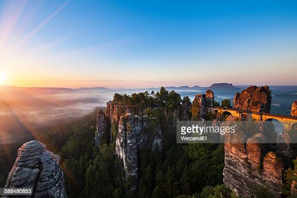 Germany, Saxony, Saxon Switzerland National Park, Elbe Sandstone Mountains and Bastei bridge at sunrise