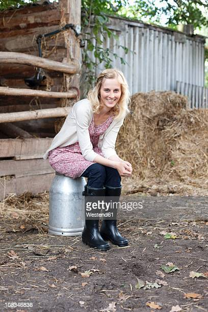 Germany, Saxony, Young woman smiling, portrait