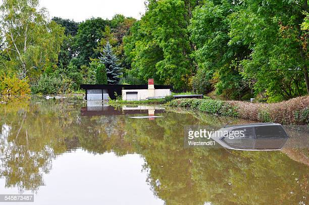 Germany, Saxony-Anhalt, Halle, Garten, Flood, sunken car and bungalow