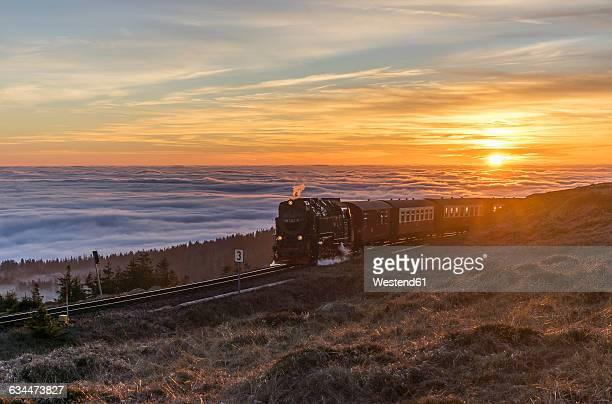 Germany, Saxony-Anhalt, Harz National Park, Brocken, Harz Narrow Gauge Railway in the evening in winter