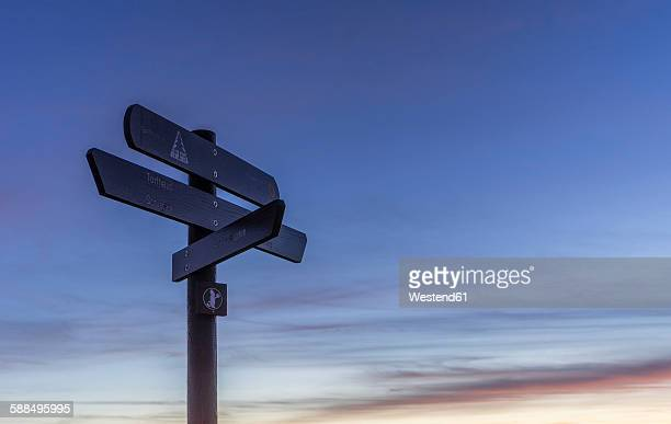 Germany, Saxony-Anhalt, Harz National Park, sign posts at Brocken in the evening