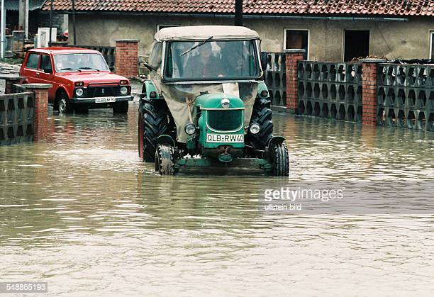 Germany Saxony-Anhalt Harz, Silberhuette - tractor and car in the flood