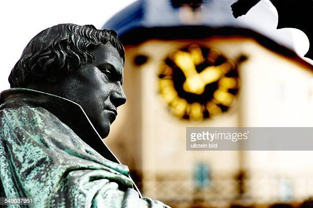 Germany SaxonyAnhalt Lutherstadt Wittenberg statue of Martin Luther on the market square in front of the Stadtpfarrkirche