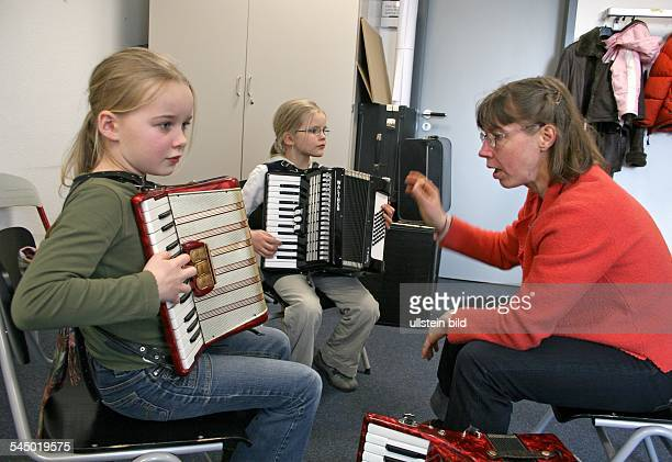 Germany SaxonyAnhalt Magdeburg academy of music Georg Philipp Telemann pupil and teacher are playing the accordion