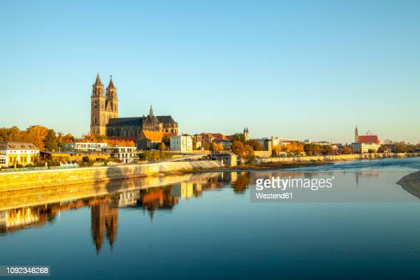germany, saxony-anhalt, magdeburg, cathedral of magdeburg and elbe river - saxony anhalt stock pictures, royalty-free photos & images