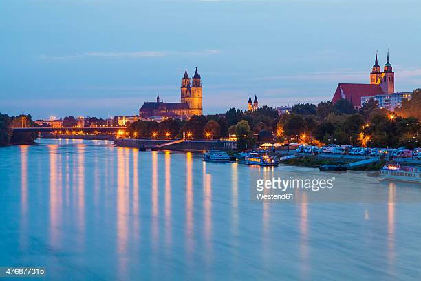 Germany, Saxony-Anhalt, Magdeburg, Cityscape with River Elbe at dusk