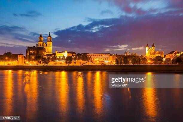 Germany, Saxony-Anhalt, Magdeburg, Cityscape with River Elbe, monastery and cathedral at dusk