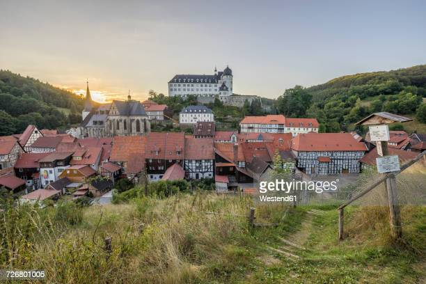 germany, saxony-anhalt, stolberg, townscape and stolberg castle in the evening - saxony anhalt stock pictures, royalty-free photos & images