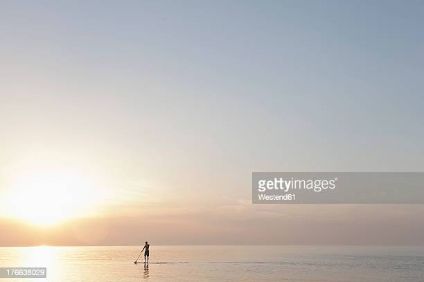 Germany, Schleswig Holstein, Man rowing on Baltic sea