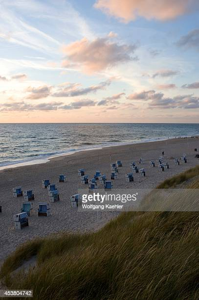 Germany Schleswig Holstein North Sea North Frisian Islands Sylt Island Weststrand Near List View Of Beach With Beach Chairs In Evening Light