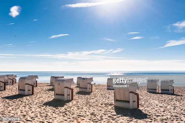 Germany, Schleswig-Holstein, Bay of Luebeck, hooded beach chairs on the beach